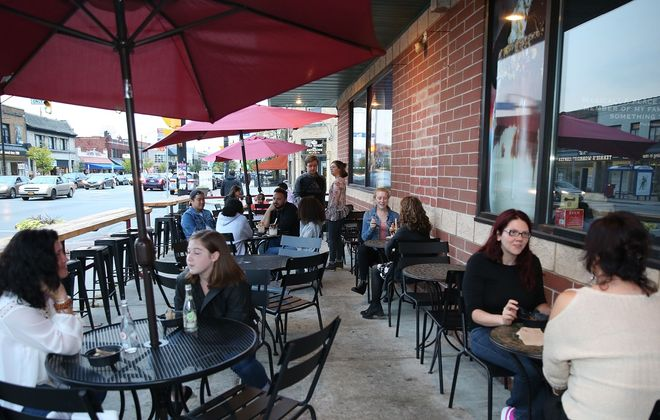 Suggested expansion of outdoor seating might allow places like Hertel Avenue's Poutine & Cream to consider setting up tables in parking lots. (Sharon Cantillon/News file photo)