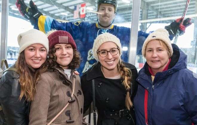 Smiling faces, and one pseudo-photobomber, from the 2019 Labatt Blue Pond Hockey Tournament, which runs again this weekend. (Don Nieman/Special to The News)