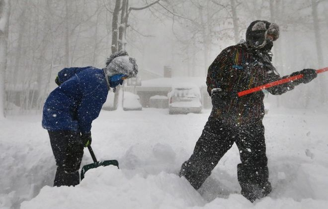 Children clear snow amid the great storm of 2014, in Orchard Park. (Mark Mulville/Buffalo News)