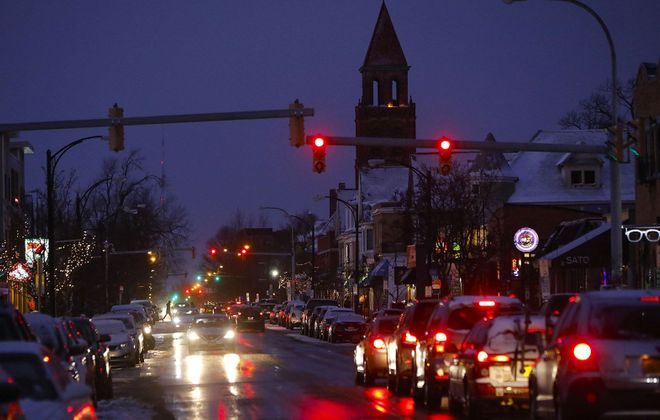 Traffic lights and cars paint the Elmwood Strip red as night falls. But digital information boards and other innovations could be added to the mix as Buffalo explores the intersection of technology and transportation.  (Derek Gee/Buffalo News)