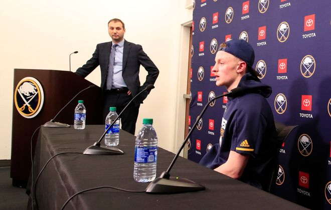Chris Bandura listens to Jack EIchel speak after defeating the Washington Capitals at KeyBank Center, on Monday, March 9, 2020. (Harry Scull Jr./Buffalo News)