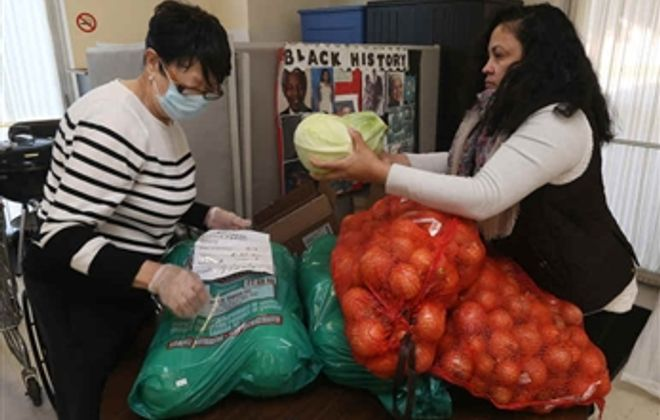Community Health Workers help prepare donated food for distribution