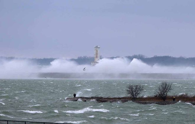 Wind driven waves from Lake Erie break over the breakwall at the North Entrance to the outer Harbor  in Buffalo, on Monday, April 13, 2020. (John Hickey/Buffalo News)