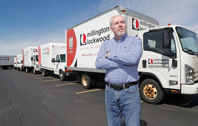 Joe Conley, CEO of Millington Lockwood, stands in his Genesee Road parking lot near the airport in Cheektowaga that would be full of workers' cars and absent of their contractors' trucks doing installs and deliveries on Monday, April 13, 2020. (Robert Kirkham/Buffalo News)