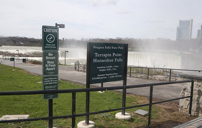 A sign asking people to maintain social distancing at Niagara Falls State Park's Terrapin Point on Goat Island. (John Hickey/Buffalo News)