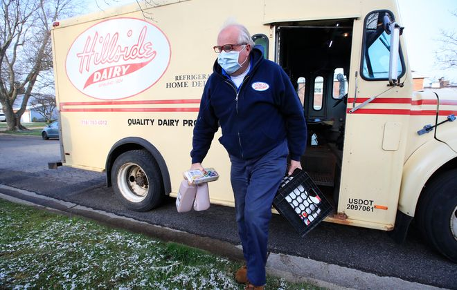 Bradley Hellert, the owner of Hillside Dairy, makes a delivery in West Seneca. (Harry Scull Jr./News file photo)