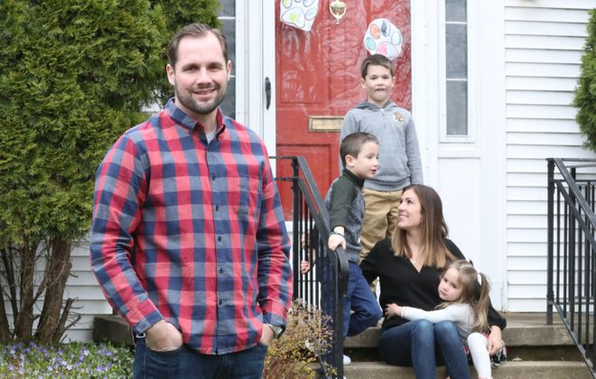 """""""I want everyone, including people my age, to know that anything can happen,"""" says Covid-19 survivor Jeff Shepard, photographed with his wife, Chelsey, their 7-year-old twins Wayne and Simon and 3-year-old daughter Paige at their home in Amherst. (James P. McCoy/Buffalo News)"""