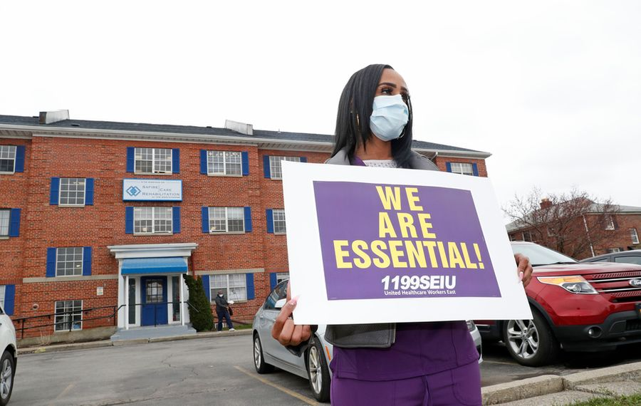 Workers in some nursing homes pressed for more personal protection equipment as the coronavirus started to hit their facilities. Here, CNA Tiffany Wright joined a demonstration in April with members of 1199SEIU United Healthcare Workers East in Tonawanda. (Robert Kirkham/News file photo)