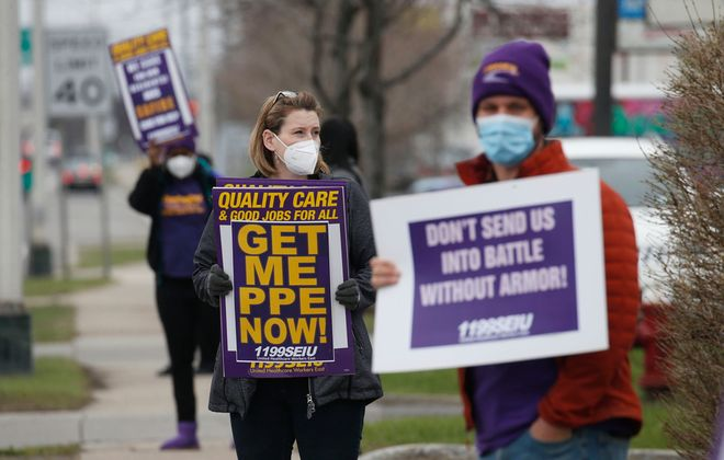 Workers at the Safire Rehabilitation of Northtowns nursing home and 1199SEIU union representatives protested last month outside the facility in the Town of Tonawanda, saying they lack enough personal protective equipment or safety training. New York does not track infection rates of workers at nursing homes. (Robert Kirkham/News file photo)