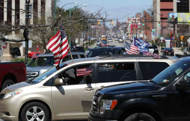 """""""Gridlock Buffalo"""" held an in-car demonstration in which protesters circled Niagara Square on Monday, April 20, 2020. (James P. McCoy/Buffalo News)"""