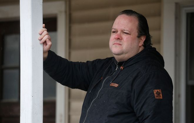 Chris Mattucci at his North Tonawanda home, said he's at the end of his rope waiting for unemployment pay to show up. (Robert Kirkham/Buffalo News)