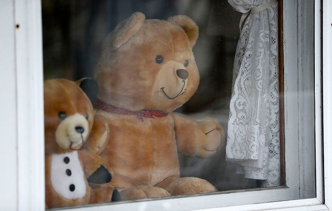 Teddy bears smile at passersby in the window of a home on Central Avenue in Hamburg Friday, April 24, 2020.   (Mark Mulville/Buffalo News)