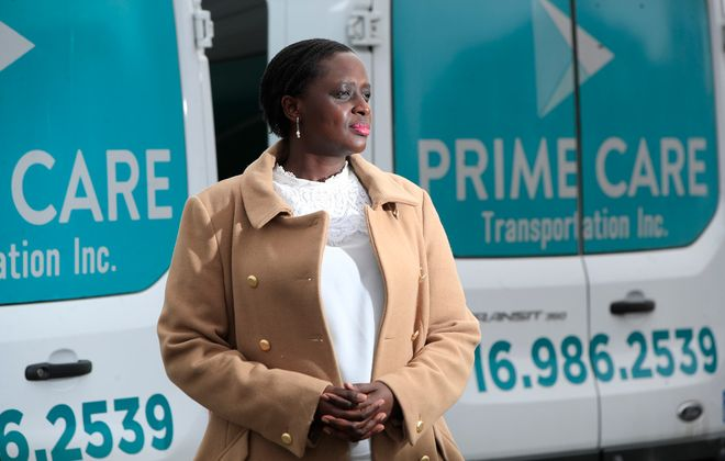 Christine Uwimbabazi, owner of Prime Care Transportation, outside her business, which is struggling due to the Covid-19 pandemic. (Harry Scull Jr./Buffalo News)
