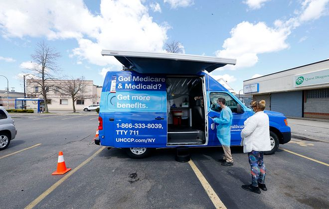 A mobile testing facility screens for Covid-19 outside Urban Family Practice on Jefferson Avenue on April 27, part of a concentrated effort focused on the hard-hit African American community. But what will happen to that focus once the pandemic passes?  (Mark Mulville/Buffalo News)