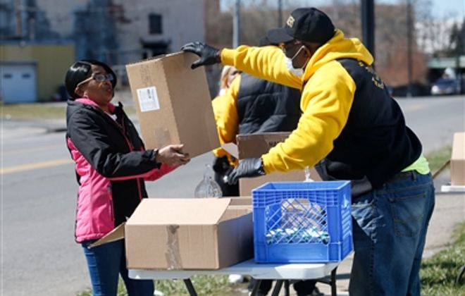 Giving meals to those in need on East Side