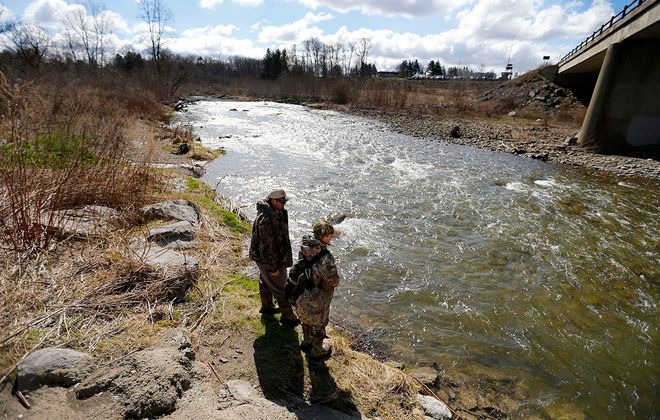 Felix Hromchak and his son, Alex, fish the Cattaraugus Creek in the Town of Sardinia on the first day of trout season, Wednesday, April 1, 2020. (Mark Mulville/Buffalo News)