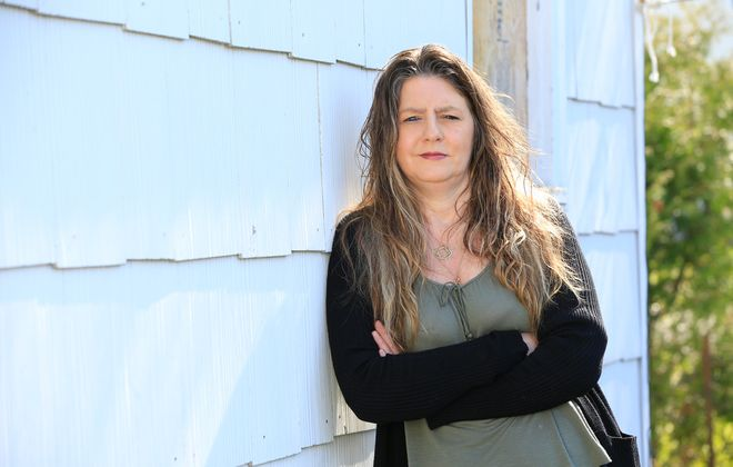 Cheryl Coldicott, a single mom of two, was laid off from her job as a bartender at Rafferty's Irish Pub due to the Covid-19 pandemic. She's pictured outside her Depew home. (Harry Scull Jr./Buffalo News)