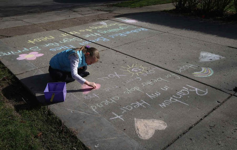 Lisa Wright is an ELA seventh grade teacher at North Tonawanda Middle School. She has motivated her neighbors including Colleen Kearney, 7, writing Haiku poems and doodles on the driveway with chalk. April is National Poetry Month.  (John Hickey/Buffalo News)