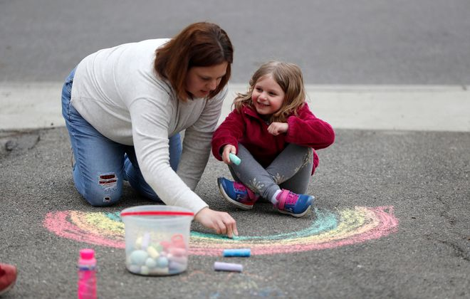 Nora Schobert and her mother, Mindy, make a chalk drawing at the Schobert home in Amherst. (Mark Mulville/Buffalo News)