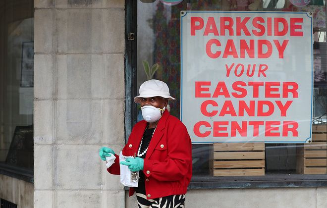 Ruth L. Kennedy buys Easter chocolate for her great grandchildren at Parkside Candy on Main Street, where owner Phil Buffamonte reports a 75% drop in Easter sales. (James P. McCoy/Buffalo News)