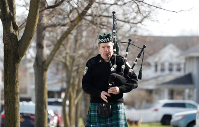 The sound of bagpipes cheers neighborhoods