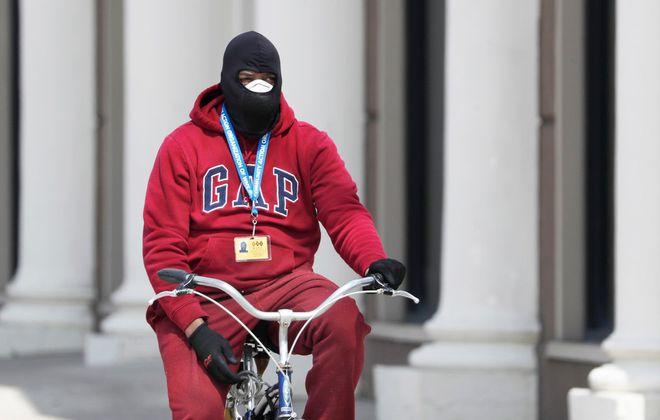 Jeff Barlow rides his bike along Main Street in Buffalo on Tuesday. (Sharon Cantillon/Buffalo News)