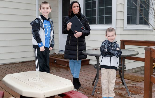 Marissa Wilson with her sons Bretton, left, and P.J. at their Clarence home. (Robert Kirkham/Buffalo News)