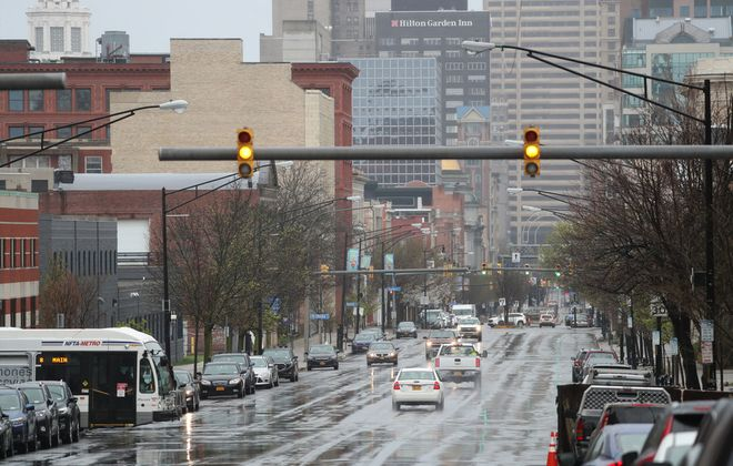 Looking at the traffic down Main Street towards downtown in a rainy day during the Covid-19 pandemic on Main Street in Buffalo,N.Y. on Thursday, April 30, 2020. (James P. McCoy/Buffalo News)