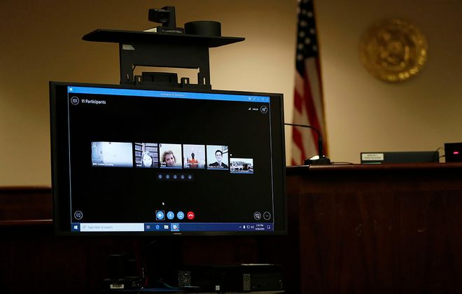 Judge Sheila DiTullio presides over a distance hearing on a screen using Skype at the Erie County Courthouse in Buffalo on Thursday, April 30, 2020. (Mark Mulville/Buffalo News)