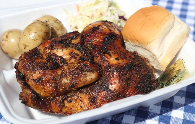 Master's BBQ is cooking up and serving chicken dinners outside its restaurant at 43 Buffalo St., Hamburg.  (James P. McCoy/Buffalo News)