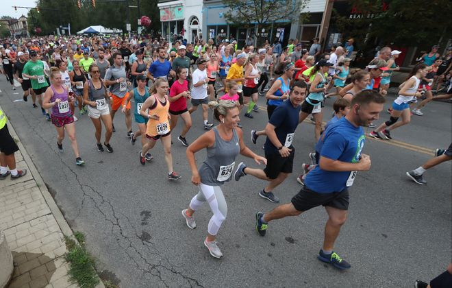 Runners start the 39th Buffalo Subaru 4-Mile Chase on Elmwood last July. Race director Jim Nowicki hopes to bring off the 40th July 17. Meanwhile, he's learning to adjust to life during the Covid-19 pandemic.  (James P. McCoy/Buffalo News file photo)
