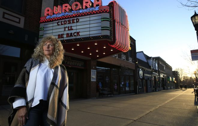 Owners of local independent movie theaters. like Lynn Kinsella of the Aurora Theatre, are facing the same challenges as other businesses. One way movie fans can still watch films and help these theaters is by participating in virtual cinema programs.  (Harry Scull Jr./Buffalo News)