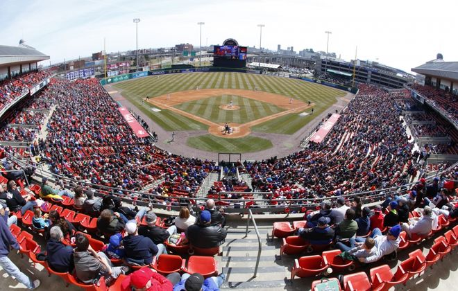 The crowd watches action between the Buffalo Bisons and the Rochester Red Wings on Opening Day at Coca-Cola Field on Thursday, April 4, 2013. (News file photo)