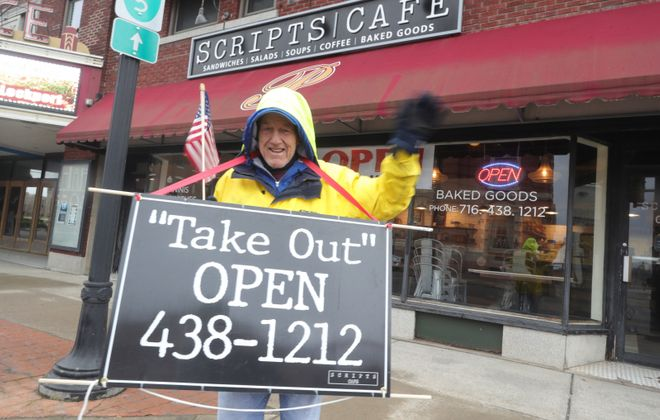 Bob Ray wears a sign to draw customers in for takeout at Scripts Cafe in Lockport. (John Hickey/Buffalo News)