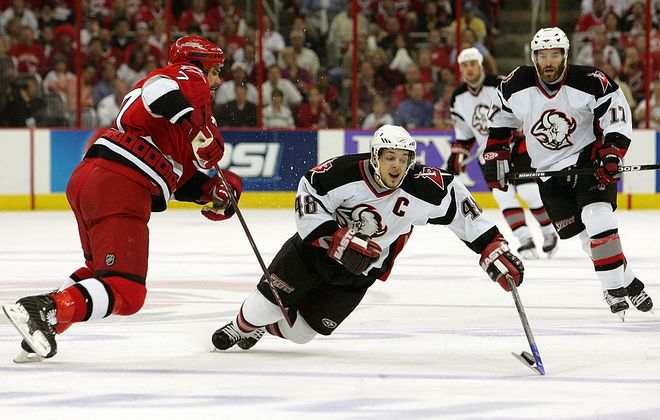 Daniel Briere (48) battles for the puck during Game 7 of the 2006 Eastern Conference final at Carolina. (Getty Images)