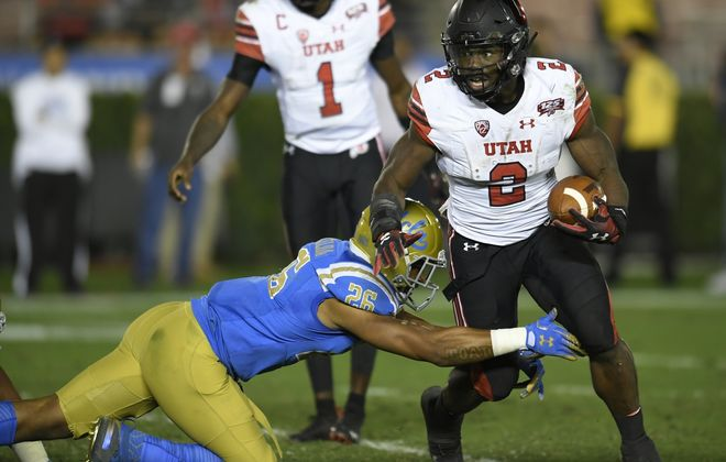 PASADENA, CA - OCTOBER 26: Zack Moss #2 of the Utah Utes runs into Leni Toailoa #26 of the UCLA Bruins in the second half at the Rose Bowl on October 26, 2018 in Pasadena, California. (Photo by John McCoy/Getty Images)