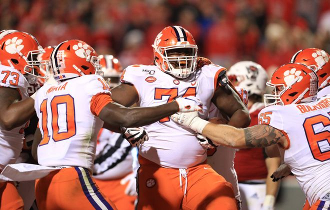 John Simpson of the Clemson Tigers reacts after running for a touchdown against the North Carolina State Wolfpack during their game at Carter-Finley Stadium on Nov. 9, 2019, in Raleigh, N.C. (Getty Images)