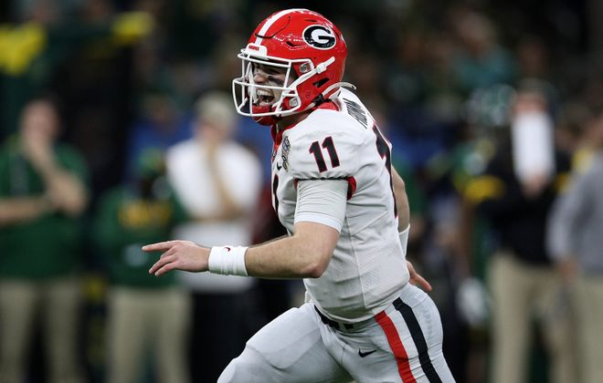 Jake Fromm of  Georgia reacts after throwing a touchdown pass (Chris Graythen/Getty Images)