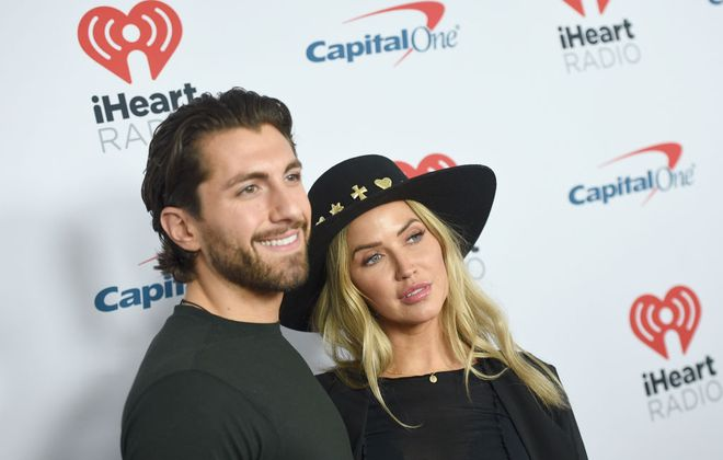 Jason Tartick and Kaitlyn Bristowe. (Getty Images for iHeartMedia)