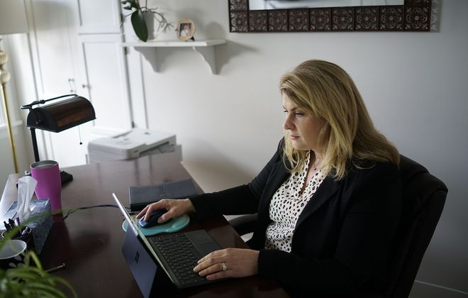 Sarah Gilson, vice president of Remedy Intelligence Staffing, works in her home office while working remotely amid the Covid-19 pandemic, Tuesday, April 21, 2020. (Derek Gee/Buffalo News)