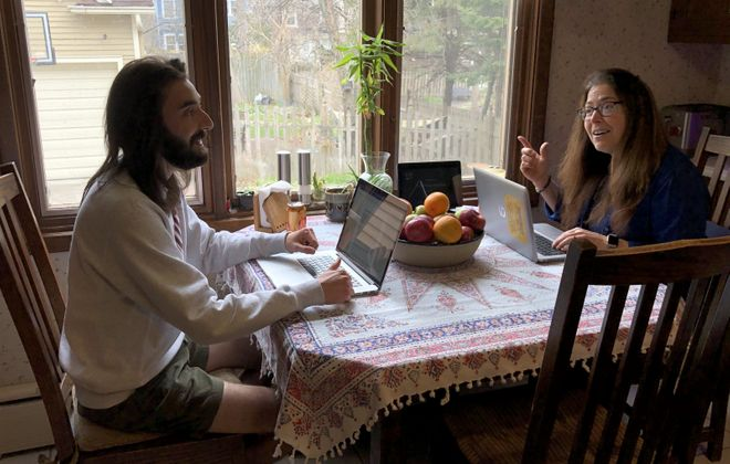 Writer Max Kalnitz shares a kitchen table workspace with his mother, Elizabeth Largeman-Kalnitz, while he's back home during the pandemic.