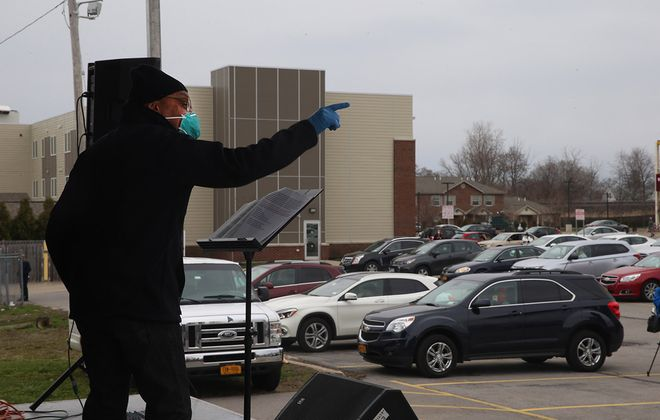 Bishop Darius Pridgen, who battled Covid-19 along with three of his children, leads a drive-in Easter Sunday service in the parking lot of his True Bethel Baptist Church in Buffalo, on April 12, 2020. (John Hickey/Buffalo News)
