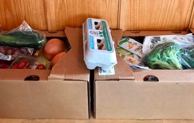 The two boxes of produce and more from Sunset Fruits & Vegetables and Produce Peddlers, sent from 19 Ideas to its employees for food during the pandemic. (Photo courtesy of Jon Tashjian of 19 Ideas)