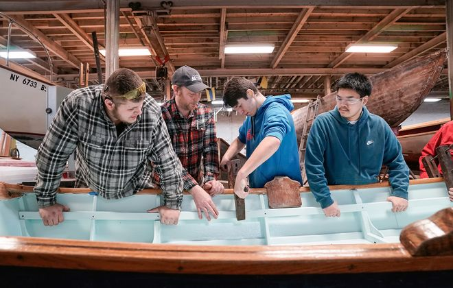 Students in Buffalo Maritime Center's Hand-to-Hand program learn craftsmanship and STEM skills while building rowboats for Hoyt Lake. (Dave Jarosz)