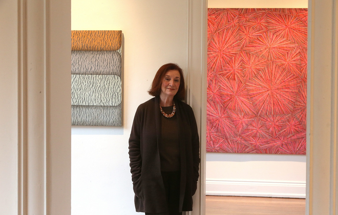 Nina Freudenheim in her gallery surrounded by the work of Peter Stephens in 2012. (Robert Kirkham/ Buffalo News)