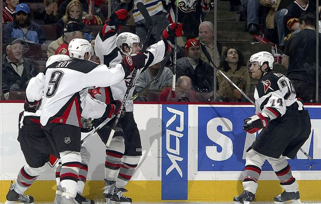 Jason Pominville (middle) celebrates his series-winning overtime goal with Derek Roy (9) and Jay McKee (74) during Game 5 of the series at Ottawa on May 13, 2006. (Getty Images)