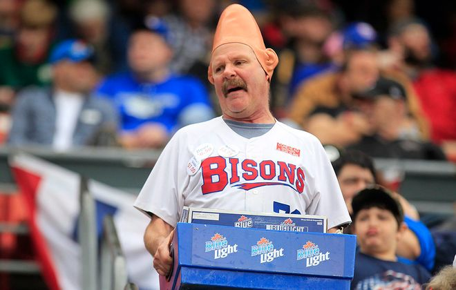 """""""Conehead"""" Tom Girot, sells beer on opening day in 2015. (Harry Scull Jr./Buffalo News)"""