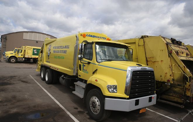 Town of Tonawanda  garbage trucks at the town Sanitation Department on Friday, April 10, 2020. During the past two weeks, because of Covid-19 safety concerns, town workers having been mixing recyclables and regular garbage in one truck during their trash pickups. (John Hickey/Buffalo News)