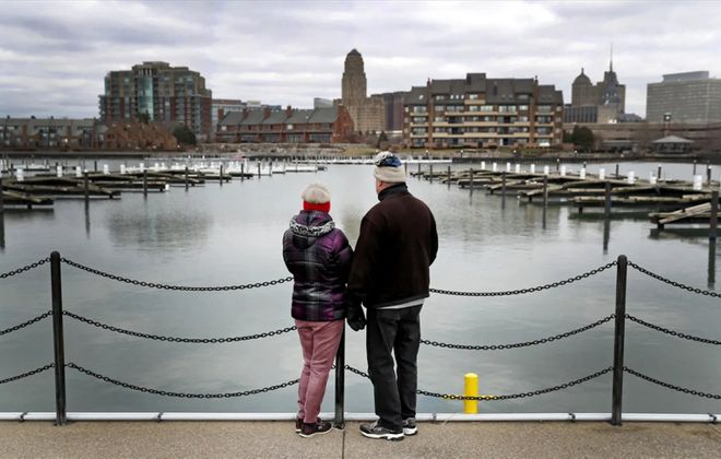 Taking a brief respite from sheltering at home as recommended by health professionals to avoid the spread of Covid-19, Richard and Sharon Darisse of the Town of Tonawanda treated themselves to a take-out lunch near their home and took in some fresh air at the Erie Basin Marina in Buffalo on Tuesday, March 24, 2020. (Robert Kirkham/Buffalo News)