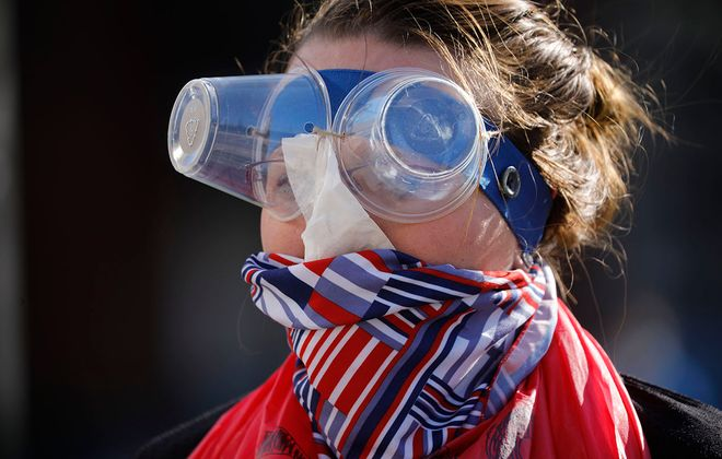 Jennifer Hogue, a CWA member and health care worker at a local hospital, wears homemade protective gear during a protest a lack of available PPE amid the Covid-19 pandemic during a rally in Niagara Square, Thursday, April 2, 2020. (Derek Gee/Buffalo News)